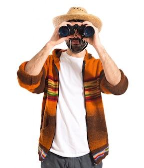 Tourist with binoculars over white background