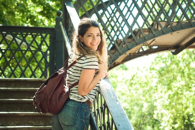 Tourist woman on the bridge in the park