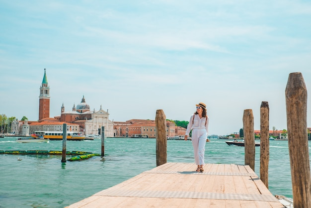Tourist woman looking at basilica san giorgio maggiore venice italy copy space