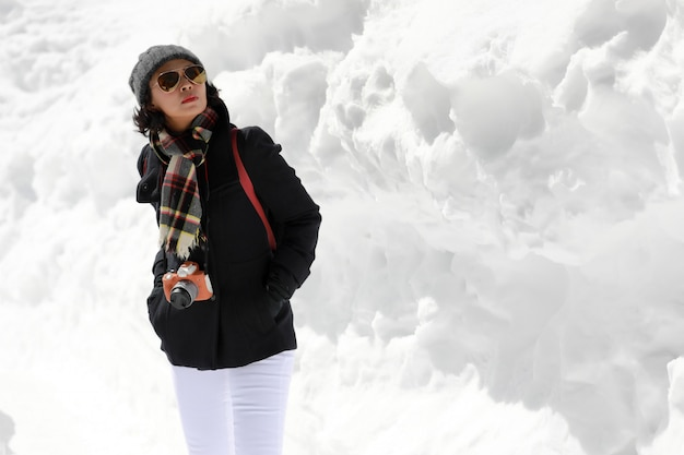 Tourist woman in the white snow wall.