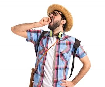 Tourist yawning over white background