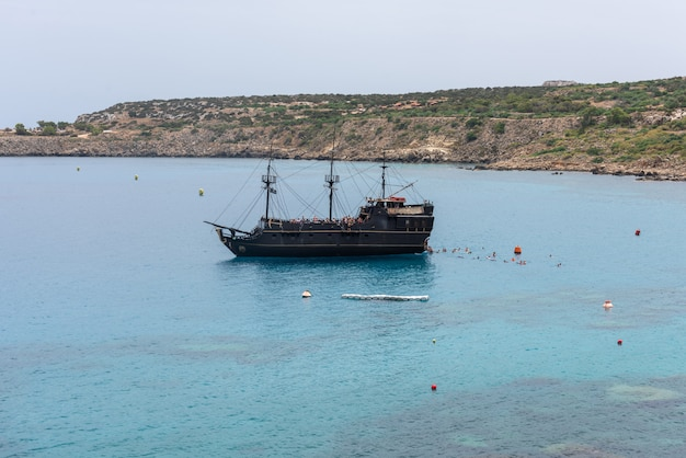 Touristic boat navigating in the mediterranean sea in cyprus