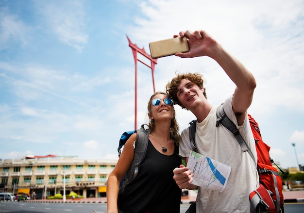 Tourists couple taking selfie with the giant swing in bangkok thailand