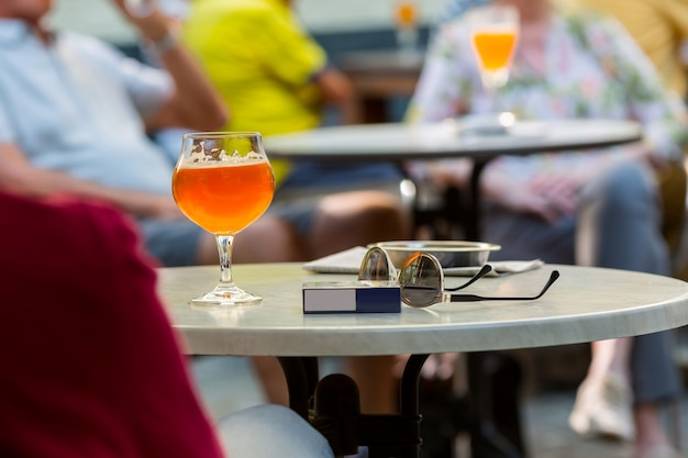 Tourists drinks beer in street cafe, europe