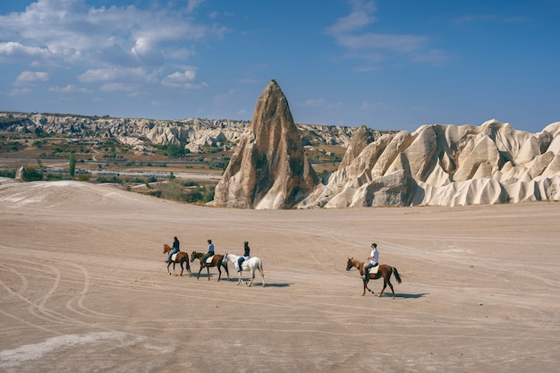 Tourists enjoy ride horses in cappadocia, turkey