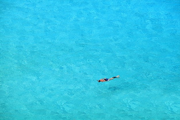 Tourists enjoying the clear waters and beautiful of similan islands, andaman sea, thailand