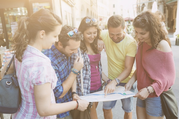 Tourists looking at city map in pisa.