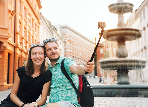 Tourists making selfie photo on motion action camera in old center of ljubljana slovenia