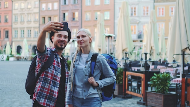 Tourists making selfie on smartphone in the city center
