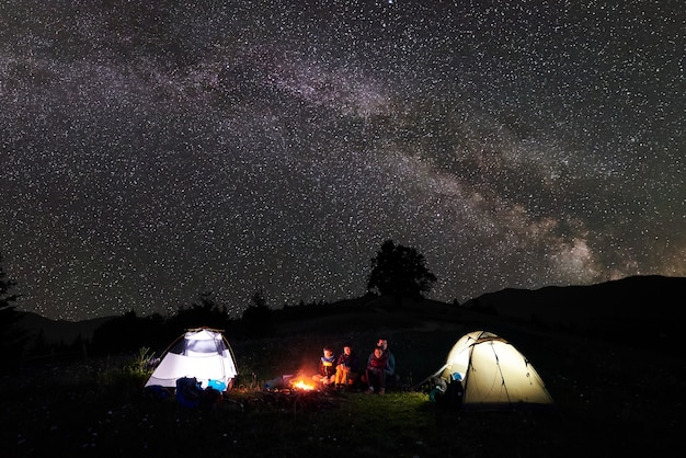 Tourists at night camping in mountains
