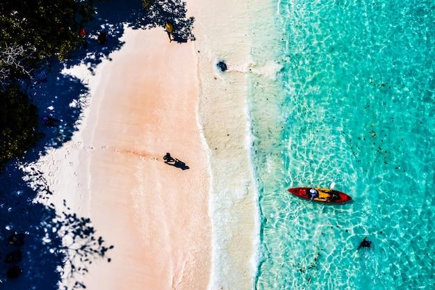 Tourists paddle kayak in boulder island, myanmar