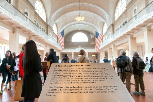 Tourists in the registry room, ellis island, jersey city, new york state, usa