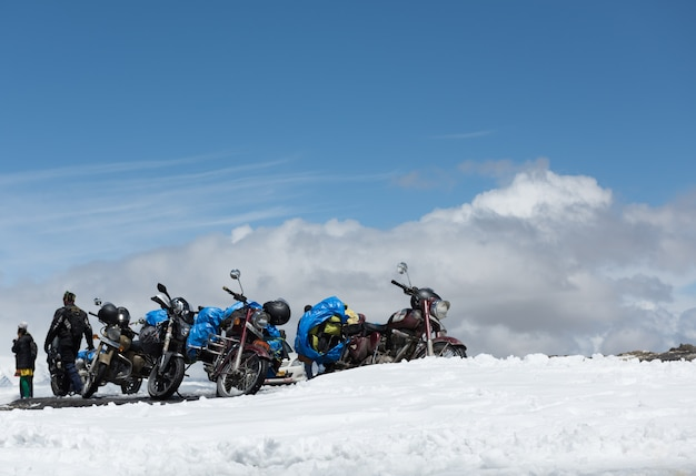 Tourists relaxing on the summit of the tanglang la pass is the second highest motorable road in the world