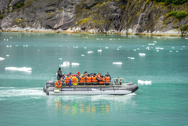 Tourists on a small boat to a glacier in alaska
