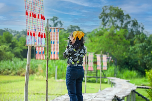 Tourists standing to take pictures beautiful natural scenery at homestay in the forest house