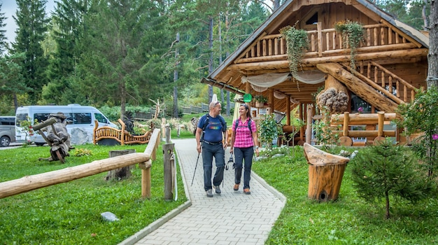 Tourists taking a stroll around hija glamping lake bloke at nova vas, slovenia