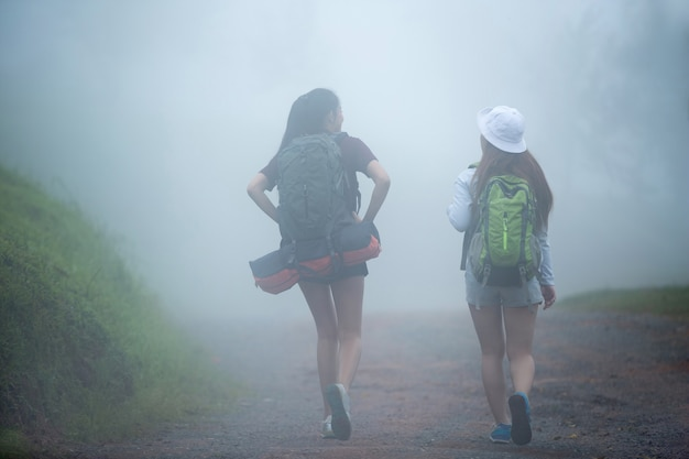 Tourists travel are walking in the presence of fog