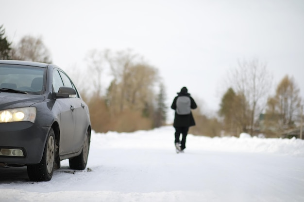 Tourists travel through the snowy country. on the way, walk and hitchhike.