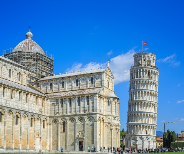 Tourists visit the famous leaning tower       italy