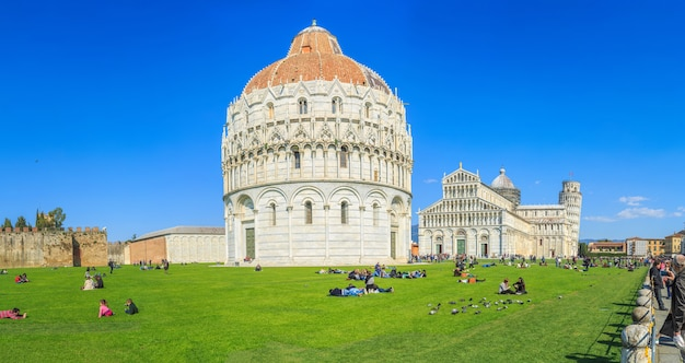 Tourists visit the famous leaning tower pisa italy