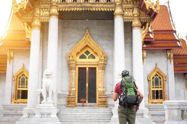 Tourists visit wat benchamabophit in bangkok thailand