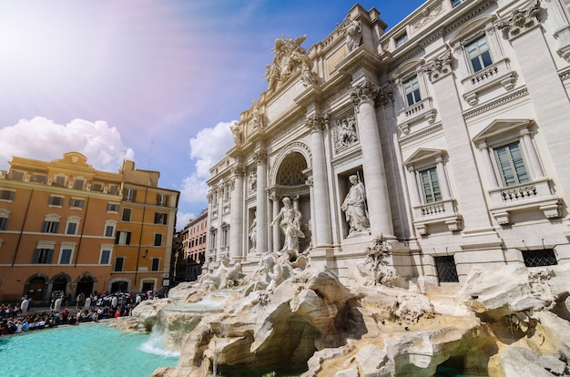 Tourists visiting the trevi fountain