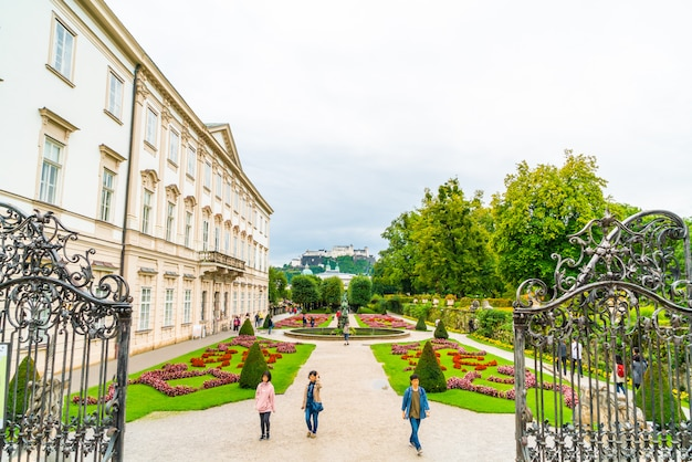Tourists walking around mirabell palace and gardens