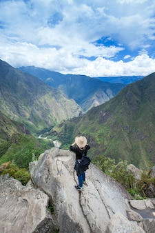 Tourists walks in machu picchu mountains