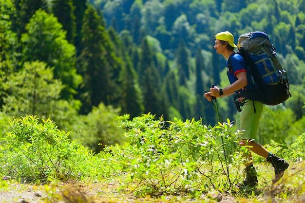 Touristwith backpacks enjoying hiking.