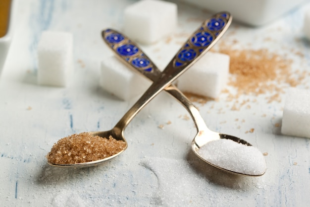 Tow spoons with sugar