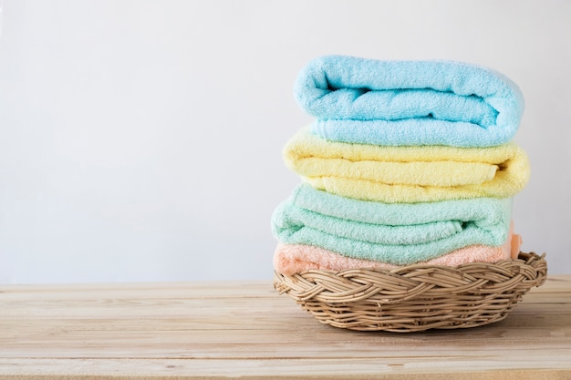 Towel on basket on wood table