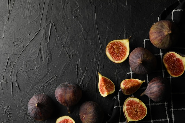 Towel and fig on black, copy space
