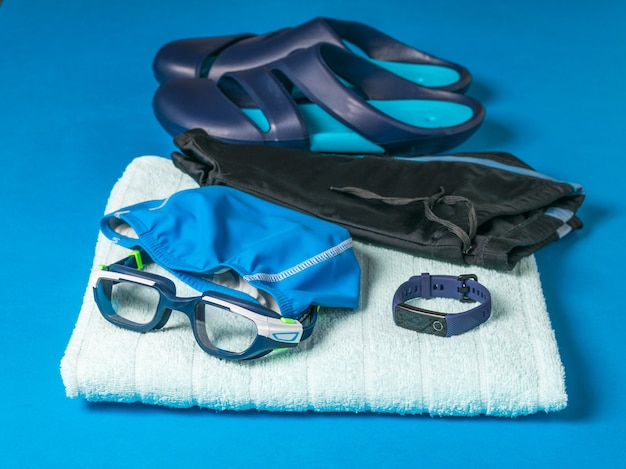 Towel, hat, glasses and swimming trunks. accessories for swimming in the pool.
