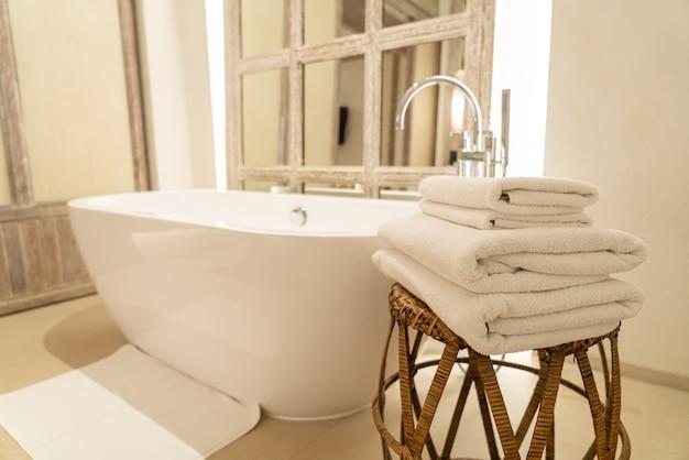 Towel with bath tub in luxury bathroom