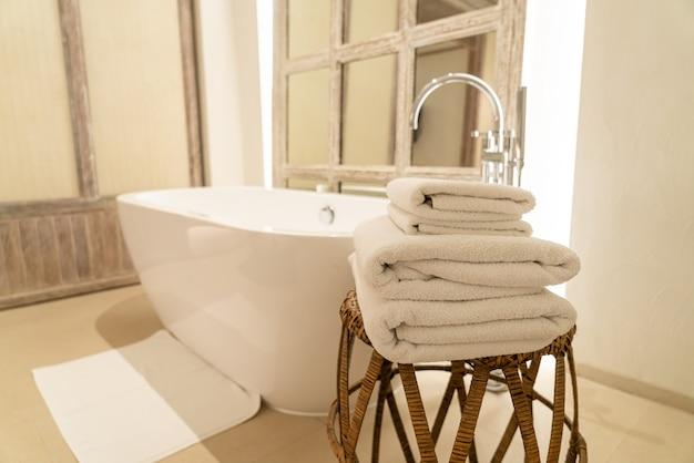 Towel with bath tub in luxury bathroom Premium Photo