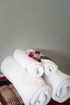 Towel with orchid decoration in bedroom interior for hotel customer.