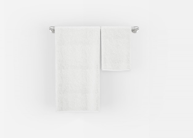 Towels on a hanger on a grey wall
