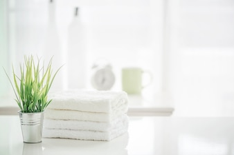 Towels On White Table With Copy Space Blurred Bathroom Background