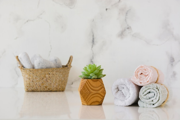 Towels set with basket on table