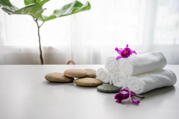 Towels on table with copy space blurred bathroom background.