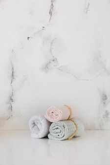 Towels on table with marble background and copy space