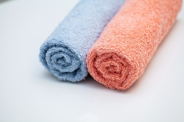 Towels on white table in bath room .