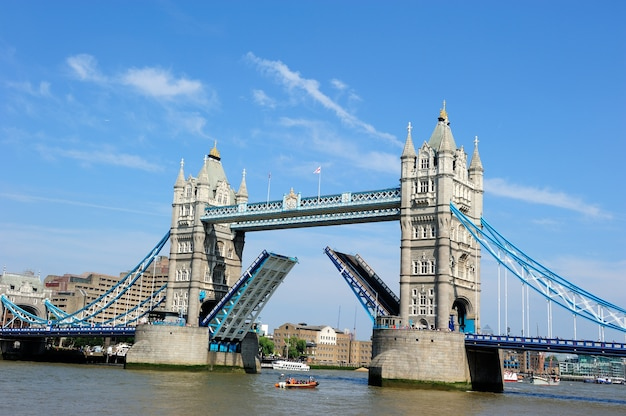 Tower bridge opens over the river thames in london, england, uk