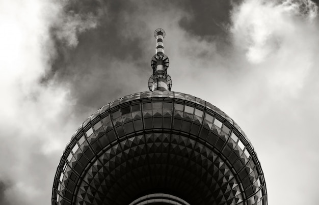 Tower of a building in front of the sky in black and white