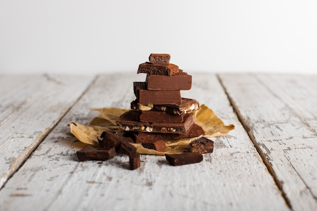 Tower of chocolate sweets on paper bag