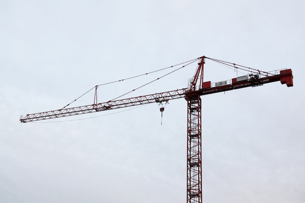 Tower construction cranes in white sky