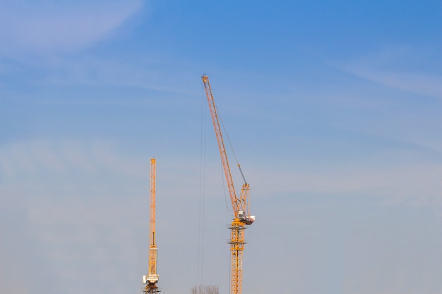 The tower crain for construction building in blue sky background