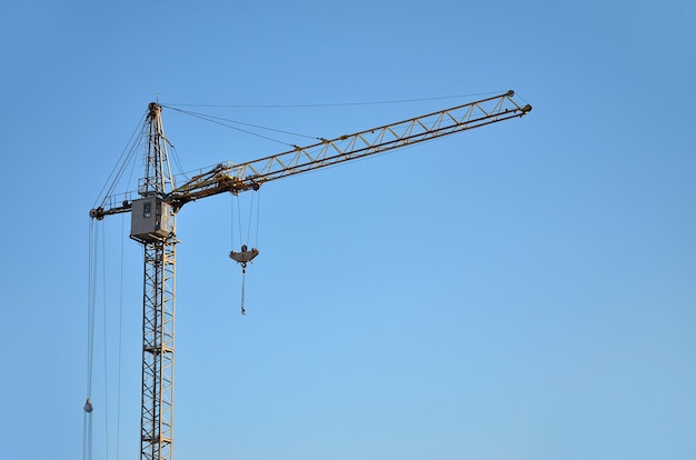Tower crane against a blue sky