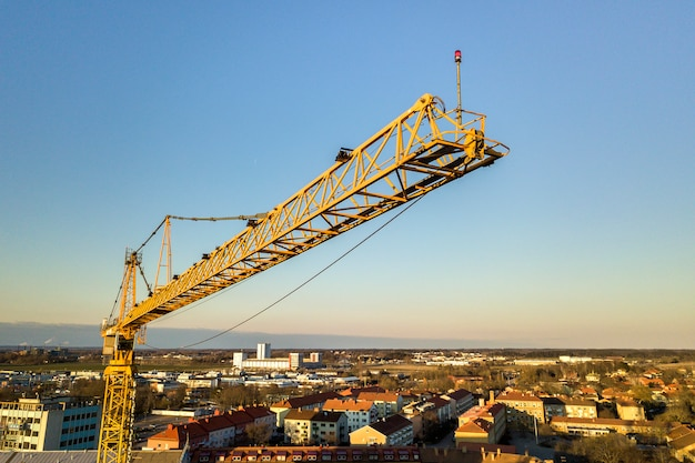 Tower crane and city landscape stretching to horizon.