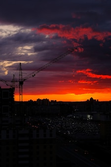 Tower crane during the sunset of the city